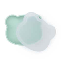 A silicone bowl with a suction cup and a lid. We Might Be Tiny Bear - Minty Green